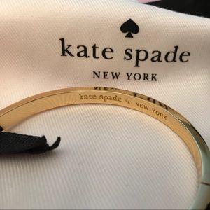 Kate Spade fuchsia bangle bracelet with clasp.